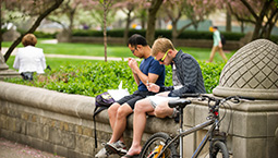 two students reading on campus